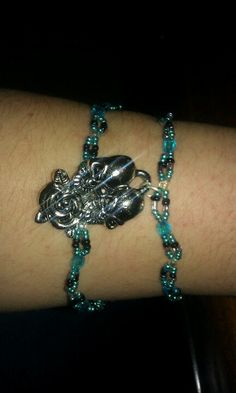 Skull double bracelet. Made with blue and black beads. I can custom make it to how you want it. Very nice. 6 dollars.