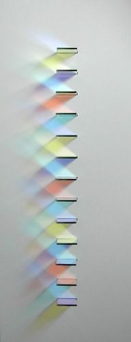 Chris Wood, Coloured Light Wall mounted panel with optical projections that manipulate light in different ways to create transient patterns of colour light and shade that change with the angle and intensity of light. 500 x 200 mm.
