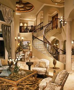 Love the staircase and the arches, but would change the curtains and the furniture...