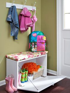 Great #DIY #Entryway Solution ~  Make the most of an entry way by adding functional storage. A few hooks and a cabinet-turned-bench do wonders for the area behind a door. Add a cushion to the top of the cabinet to create a bench that provides a convenient seat for putting on boots. Add baskets underneath to store shoes, pet supplies, and mail.