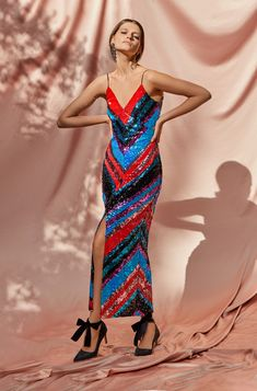 Dalia Dress  transform any woman into a glamorous one. This sequined slipdress – a favorite of ours- is decorated with scores of red, fucsia, blue and black sequins in the shape of triangles.