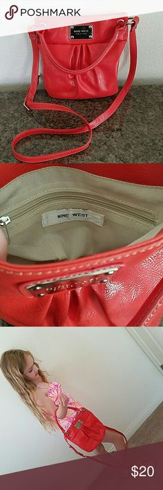 Nine west small purse Coral, blood orange small purse can be used as cross body too. Great condition, maybe used twice. Nine West Bags Crossbody Bags