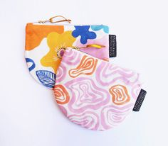 SALE Was $35, Now $28 The handy Dumpling Purse has been designed to hold all of your everyday essentials such as credit cards, cash and coins! Each purse is lovingly made by hand and features an eye-catching original Togetherness textile design - this purse features our Garden Mirage print. Topped off with a chunky zip closure and gold leather pull, this purse is a delightful number, great to give as a gift or keep for yourself. Every Togetherness Design textile starts as a hand drawn or…