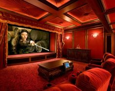Media Room Design, by Robert Bliss  Intense, classic movie house decadence. Note: upholstered ceiling