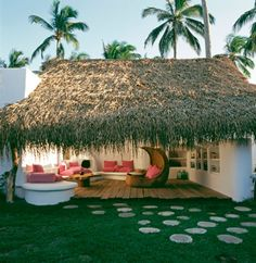 Mexico. Outdoor Shelving and all white with bright pillows. Grass is obnoxious though.