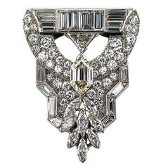 Art Deco Fancy Cut Diamond Platinum Clip Brooch   From a unique collection of vintage necklace enhancers at https://www.1stdibs.com/jewelry/necklaces/necklace-enhancers/