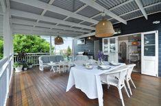 Love the deck, pendant lights, dark cladding, white trims