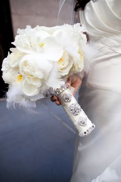 All white with white feathers, Jewls and Bling on the ribbon how beautiful. I can make this beautiful just like this :)