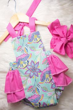 The colors in this mint and pink romper are perfect! Baby ruffle romper!