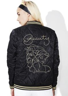 Mink Pink Fair Facade Embroidered Bomber our love is a tale as old as time… This gorgeous quilted bomber jacket features a sleek black satiny construction, thick ribbed trim with glitzy golden stripe detailing, minimal embroidered graphic of Belle & the Beast across the back, and zip front closure.