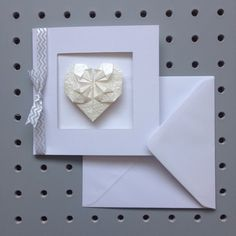 A personal favourite from my Etsy shop https://www.etsy.com/uk/listing/270090241/origami-heart-greetings-card-wedding