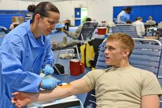 Master Sgt. Sabrina Moseley, Landstuhl Regional Medical Center NCO in charge of the blood donor center in Germany, prepares to draw blood from Airman 1st Class Tyler Wineman, 56th Rescue Squadron aircrew flight equipment apprentice, during an #ASBP blood drive on July 10. (U.S. Air Force photo by Airman 1st Class Dana J. Butler) #joinarmsrace