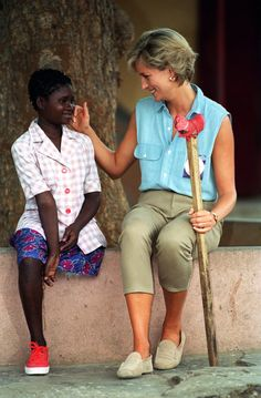 Diana returned to Angola several times after her first visit and is pictured here in 1997 with a girl who lost her leg to a land mine.  The fund currently set up in her name also works to change legislation and policy to meet international standards on children's rights.