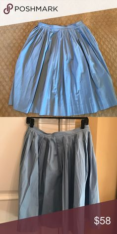 J.Crew Pleated Cotton A-Line Skirt Awesome for Spring in a gorgeous sky blue color.  Cotton full pleated skirt.  Fits on the looser side -- very full. 97% Cotton, 3% spandex.   Lightly used.  No trades or PayPal. J. Crew Skirts A-Line or Full