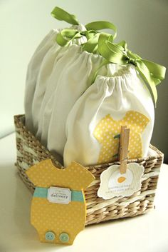 Baby Gifts: DIY baby to-go bags.  Designed to make a new mom's life less overwhelming.  Each bag has essential items from quick change to feeding and can be grabbed on the way out the door.