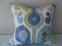 This Breamore Journey Aquamarine Ikat Pillow Cover is a Beautiful Abstract, Paisley Ikat Fabric on Both Sides and Colored in Soft Shades of Blues, Greens and Greys.   This Stylish Linen / Rayon Blend Decorative Pillow was Featured on the First Episode of Nate Berkus' Show American Dream Builders!  This Conversation Piece Accent Pillow would Look Great on Any Sofa, Chair or Bed in Your Home.