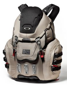 Oakley Kitchen Sink Backpack Grey Fossil - Padded panel for up to 17 widescreen laptop with side access;Front compression molded organizer panel and The Oakley Kitchen Sink has rubberized bottom Bottom shoe compartment and Dual mobile electronics holsters on shoulder straps;Compression molded brushed optics / media player pocket on...
