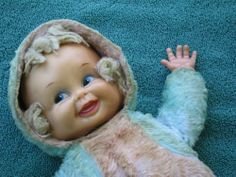 This doll's head spins around to display three different faces. No exorcism required!