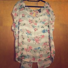 Torrid Floral Print Chiffon Blouse Spring & Summer Favorite!!! This blouse features a beautiful floral print and a slight three button opening in the back.  Great condition. SIZE 1 (14/16) torrid Tops Blouses