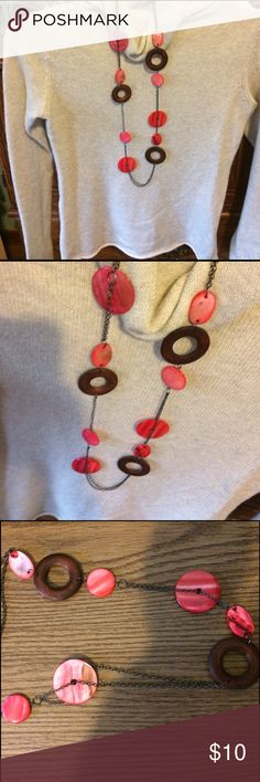 """Necklace w/ earings set Never worn was given to me as a gift. It's cute. About 19"""" long.  No clasp just throw it over your neck.  Brown and a reddish pink color. Not expensive comes with a pair of wooden brown earrings. Jewelry Necklaces"""