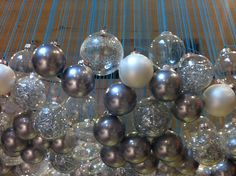 Gorgeous Christmas balls hanging from blue yarn in the ceiling...super easy and stunning!!!
