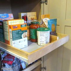Install pull-out shelves to maximize lost space in deep cabinets. Use drawer dividers to organize pantry items on the shelves. Want other ideas for kitchen cabinet organizers? Check out these cabinet and drawer organizers you can build yourself.