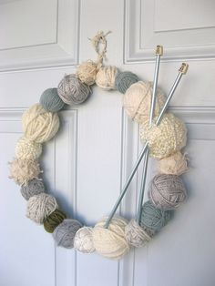 Do you have a passion for knitting? Why not use some of your leftover supplies to make a yarn-ball wreath. You will need a few balls of yarn, a wire coat hanger and a pair of knitting needles. Knitted Christmas Decorations, Christmas Wreaths, Christmas Crafts, Fall Wreaths, Christmas Ornaments, Door Wreaths, Xmas, Floral Wreaths, Burlap Wreaths