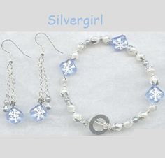Snowflake Imitation Pearl Blue Glass Bracelet Earring Set by Silvergirlscreations on Etsy https://www.etsy.com/listing/213756082/snowflake-imitation-pearl-blue-glass
