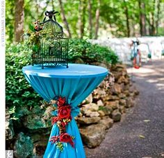 Bistro tables were scattered throughout the space. This one was topped with a birdcage to hold cards.
