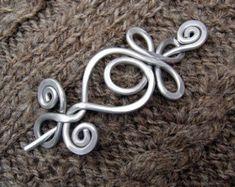 Aluminium tanzen wirbelt und Wellen-Schal-Pin von nicholasandfelice