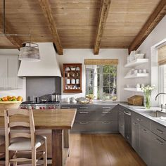 Kitchen with Open Shelving and Wood Beams | Ryan Street & Associates