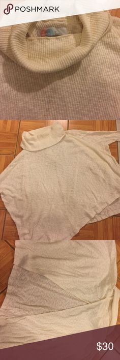 NWOT Free People Beach Collection Top From the FP Beach Collection. New Without Tags. •Lightweight •Can be worn causally, or dressed up •Turtle Neck •Oversized fit, with open back •48% Cotton/ 48% Polyester/ 4% Spandex •Can fit as XL •Color: Cream • Sleeves come down to elbows NO TRADES OFFERS WELCOMED! BUNDLE TO SAVE  FEEL FREE TO ASK ANY QUESTIONS Free People Tops Sweatshirts & Hoodies