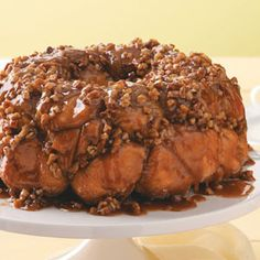Caramel-Pecan Monkey Bread ..  soft, sweet, melts in your mouth!    Hints:   Use a large bundt pan because it will overflow in a standard size.   Do not overcook because the dough should be slightly soft.    It takes more time than using pre-made biscuits, but there's no comparison in taste. Caramel Pecan, Our Daily Bread, Monkey Bread, Taste Of Home, Home Recipes, Pressure Cooker Recipes, No Bake Desserts, Breakfast Recipes, Rolls