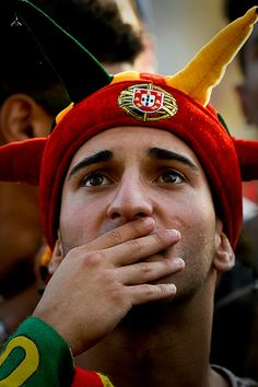 #EURO2016 A Portugal football team's supporter gestures as he watches on a giant screen displayed at Terreiro do Paco square in Lisbon on July 6 the Euro 2016...