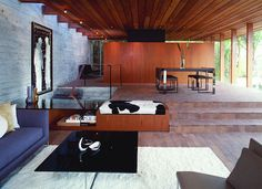 Wood paneled ceilings + cowhide upholstery help to complement this #midcentury #modern #living room