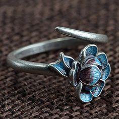 An absolutely stunning lotus ring from the Egret collection. Cast from sterling silver into an intricate blue enamel lotus flower, this ring has a lovely organic look and feel to it. Silver Pendant Necklace, Sterling Silver Necklaces, Cute Jewelry, Jewelry Gifts, Jewellery, Open Ring, Handmade Rings, Sterling Silver Flowers, Purple Gold