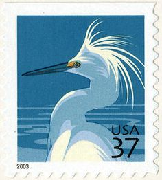 The 37-cent Snowy Egret definitive stamp was issued four times between the years 2003 and 2005. The stamp was designed by Carl T. Herrman, Carlsbad, California, and features artist Nancy Stahl's rendering of a snowy egret, which is considered one of the most beautiful American birds. The stamp art, based on photographs, depicts the head and upper body of a snowy egret against a blue background.