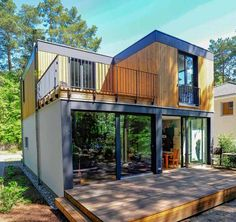 Settling in a tiny house is more than just a trend—it's a lifestyle choice that people all . Modern Tiny House, Tiny House Cabin, Tiny House Living, Tiny House Design, Tiny Houses, Living Room, Sauna House, Prefabricated Houses, Container House Design