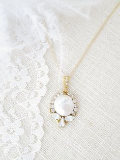 For the Bride who wants simple yet elegant, this pendant necklace features Swarovski crystals in a halo effect around a natural baroque pearl. The mix of white shades make for a necklace with uncommon cool.