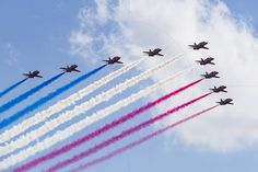 RAF Red Arrows in BAE Hawk T1 trainers Farnborough International Airshow Farnborough Airport Rushmoor Hampshire England  www.alamy.com/image-details-popup.asp?ARef=FC3220  #raf #red #team #jet #airplane #air #plane #display #aviation #airshow #force #hawk #arrows #flight #aerobatic #formation #sky #smoke #aircraft #royal #show #teamwork #military #flying #speed #fast #stunt #british #pilot #wing