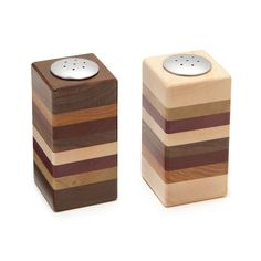 """LAYERED WOODEN SALT AND PEPPER SHAKER SET (UncommonGoods) (Handmade by Gregg W. Palm in Interlochen, Michigan, from walnut wood, stainless steel, pad auk, maple wood, black limba, purpleheart, and canary wood.) (2"""" L x 2"""" W x 3.88"""" H)"""