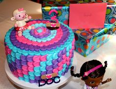 """Doc Mcstuffins Buttercream Petal Cake made with 3 layers (10"""" round).  Cake layers were colored also...1 pink, 1 purple and 1 blue to match the icing."""