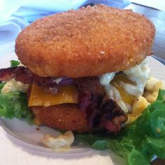 Mac & Cheese Burger Bun made out of Mac & cheese that's been battered and fried! Impossible to pick up and eat, but so delicious! Zombie Burger, Des Moines, IA
