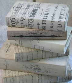 white shabby book boxes but could also be books wrapped in wrapping paper or a decorator paper