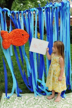 portable backdrop for photos... use streamers on rope to hang... maybe throw a net over it with a banner?