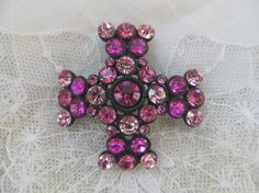 Vintage Maltese Cross Brooch Pendant Pink Rhinestone in shades of pink in a japanned setting.  Bright and sparkling stones, some wear to paint on the back.  Wonderful vinta...