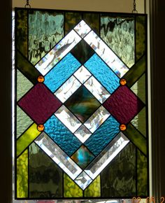 Geometric handmade stained glass window panel green forest purple