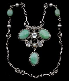 Mary Thew. Arts and Crafts necklace and pendant. Silver, jade, goshenite and pearl, c. 1920. H: 6.3 cm (2.48 in); W: 5 cm (1.97 in).  Marks: 'T' maker's monogram. Sold by Tadema Gallery. View 2.