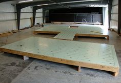 Finished flooring assemblies with Warmboard radiant subfloor installed.
