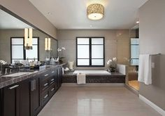 A lighted mirror mixes a bathroom light fixture and a mirror together to make a very useful and modern product for your bathroom. It is perfect for a morning routine and for general task lighting, it is efficient and an easy choice if you are looking for modern bathroom lighting but don't want the hassle of choosing various fixtures yourself.